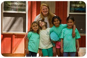 A cabin of four first-year campers pose with their counselor.